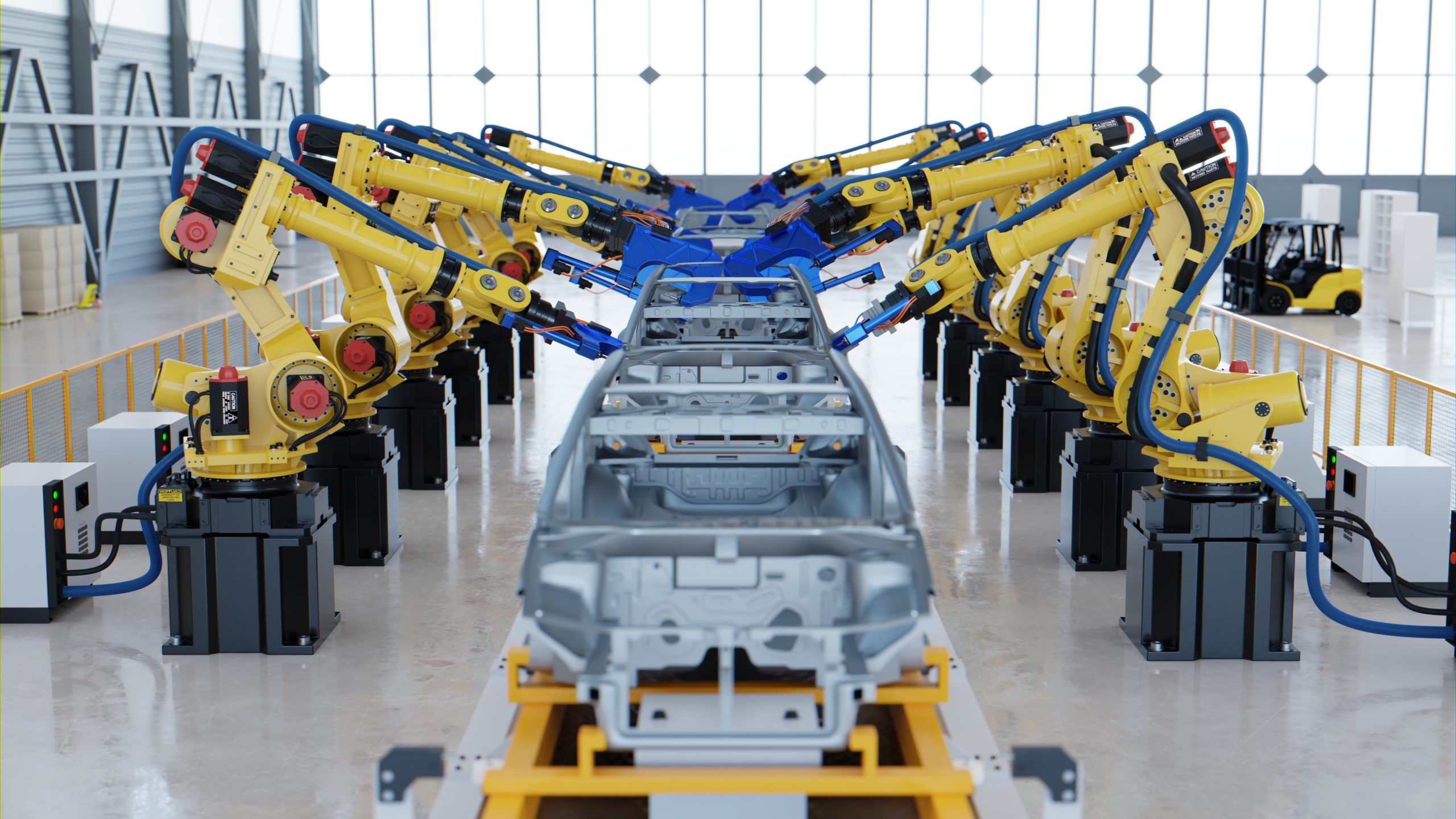 Robotic automotive assembly in factory.